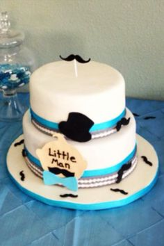 A baby shower cake! First time I ever saw this theme with the mustaches and stuff. I'm always into trying something different.