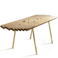 """Berlin-based The Fundamental Group works within the realm of what they call """"the architecture of fascination,"""" and their Atlas Table bears this out. Made from alternating, angled blocks of oak and smoked oak, just thinking about what the glue-up must have involved gives me a headache"""