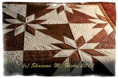 Hunter's Star  custom design and quilting by Shannon M. Hicks