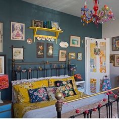 Such pretty yellows! Vintage cottage boho look, and the dark teal walls add a touch of glamor and chic!