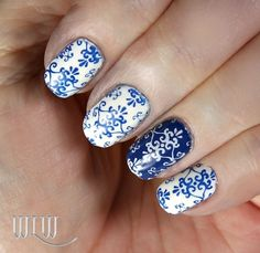"""Lola's """"Delft China"""" mani:  Sinful Colors """"Snow Me White"""", Rimmel London """"Blue Eyed Girl""""; stamped with MoYou London Tourist 07 image plate; Seche Vite top coat."""