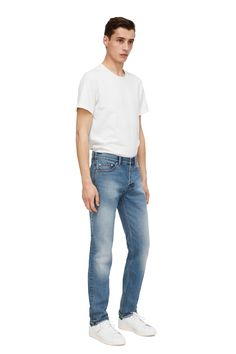 130002-365 - Standard Faded Indigo Jeans. A classic 5-pocket design, these regular-fit trousers are fashioned from rigid denim twill with a faded indigo wash. 14 oz. #ARKET