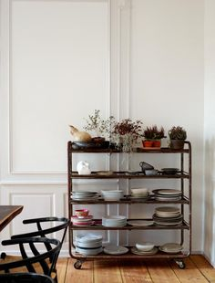 Mix-and-match ceramics stacked on an antique industrial cart.