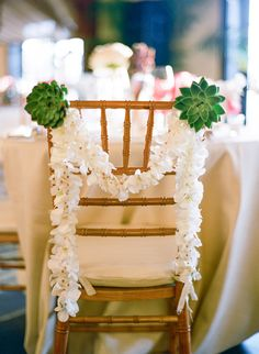 orchid and succulent wedding chair garland decoration