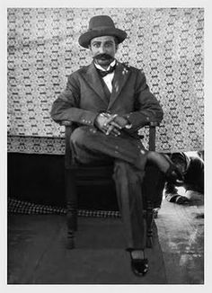 An unusual early photo of Meher Baba in western clothing.