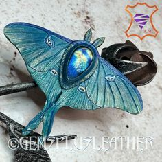 Welcome to see more pictures of this #handmade #tooledleather #luna #moth with #labradorite in my #Etsyshop #Gemsplusleather 😊 Purchasing outside #Etsy is cheaper thus rather contact me directly 😌 #Gemsforall #leather #leathercraft #Leatherwork #artisan #artisanjewelry #leatherjewelry #gemstonejewelry #jewelry #leatherjewelry #leatherart #Handpainted #giftforher #lavkacraft #handmadejewelry #gemstonejewelry #moths #hairclip #brooch Gemstone Jewelry, Beaded Jewelry, Handmade Jewelry, Handmade Items, Tooled Leather, Leather Tooling, Leather Necklace, Leather Jewelry, Hair Barrettes