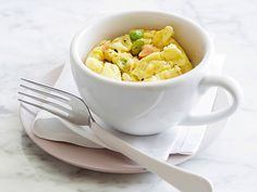 Omelet in a Mug : Spray the inside of a mug with nonstick cooking spray. Whisk together 2 large eggs, 2 tablespoons frozen mixed vegetables, 1 tablespoon low-fat shredded cheese, and some salt and pepper. Microwave 1 minute. Stir and microwave 45 seconds to 1 minute more. Let sit for 1 minute before eating (about 160 calories). via Food Network