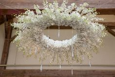 A large flower chandelier with white hydrangeas, jana spray roses, white dendrobium orchids, dripping crystals and strands of white dendrobium orchids will be suspended over the dinner tables in the center of the patio. www.stemfloral.com I www.stellaalesi.com