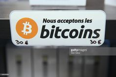 'We accept bitcoins' hangs at a display of the LedgerWallet Nano USB stick that enables security-protected transactions with bitcoins at the 2015 CeBIT technology trade fair on March 16, 2015 in Hanover, Germany. China is this year's CeBIT partner. CeBIT is the world's largest tech fair and will be open from March 16 through March 20.