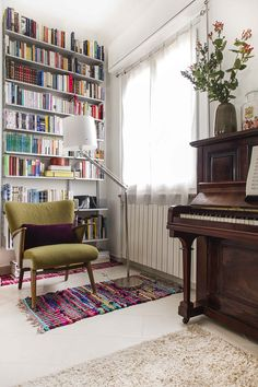 Bookcase, piano and vintage chair in my house