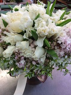 White tulips peonies with lavender lilac.