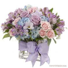 Pretty lavender, pink, and blue pastel centerpiece. This would be super pretty for an early spring wedding or bridal shower.