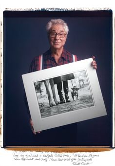 "Elliot Erwitt: ""The picture I am holding was snapped in 1974 just across the street from my apartment in New York's Central Park. It has been 38 years since that event and sadly I have lost track of the participants.""  http://creamcaravan.com/2012/01/24/famous-photogs-pose-with-their-most-iconic-images/"