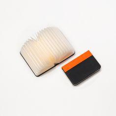 "Mini Lumio+ simple, multi-functional, portable ""book lamp""."