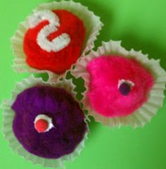 Pretty Pom Pom Cupcake Magnets are perfect kids' crafts for even the tiniest tikes. These magnets make great Valentine's Day crafts for kids, but they can be made at any time of the year!