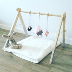 This stylish play-gym is designed for the modern family home, to be used in any space and easily transportable and stored away. The sturdy frame is cut and sanded by hand for a smooth finish with no sharp edges and painted in non-toxic water-based paint.  If you would like a custom color, please do not hesitate to ask. This listing is for the frame alone, toys are purchased separately. See listing below for our versatile hanging toy sets https://www.etsy.com/au/listing&#x2...