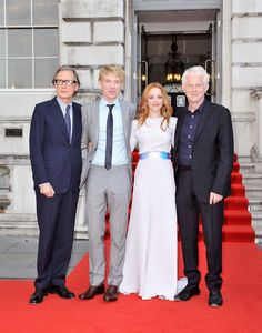 The cast of About Time pose for a photo with writer/director Richard Curtis on the red carpet.