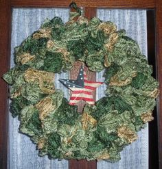 I have been playing around with the sashay scarves and this is my latest.a camo wreath. Wreath Crafts, Wreath Ideas, Diy Wreath, Yarn Crafts, Wreaths, Ruffle Yarn Projects, Sashay Yarn Projects, Camo Wreath, Crochet Ideas
