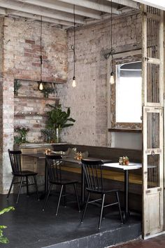 vintage restaurant with fitted seats and simple chairs:
