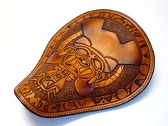 Leathersmith specializing in chop seats and saddles and custom horse tack and \ Saddle items. Motorcycle Seats, Bobber Motorcycle, Bobber Chopper, Motorcycle Leather, Bike Seat, Motorcycle Garage, Leather Carving, Leather Art, Custom Leather