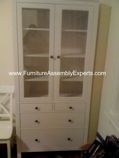 ikea Liatorp bookcase with glass door assembled in Baltimore MD by Furniture Assembly Experts Company