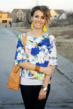 Ombre asymmetrical bob haircut paired with awesome leather accessories and a watercolor printed shirt.