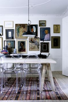 Dining room. Gallery wall, buffet table, rug.
