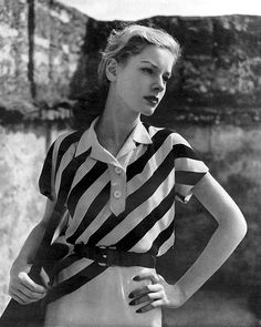 Lauren Bacall wearing a dress by Maurice Rentner by Louise Dahl-Wolfe, Harper's Bazaar May 1943