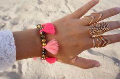- Multi pink tassel bracelet