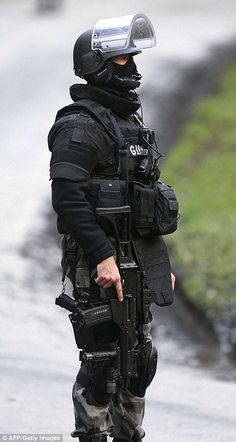 A member of GIGN, French police special forces, is pictured in Corcy, near Villers-Cotterets, north-east of Paris