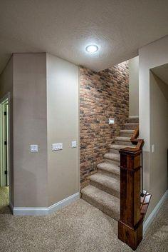 basement stairs leading to main floor; brick wall