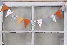 diy banner | scrapbook paper triangles sewed to a ribbon