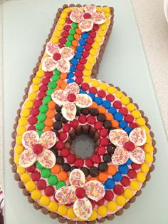 Number 6 Party Cake Decorated in Smarties, sliced marshmallows and sprinkles.
