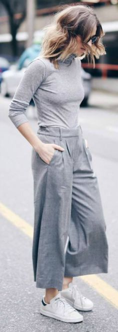 Grey on grey + culottes trends + Jill Lansky + awesome and individual style + grey turtleneck + grey culottes + simple white sneakers + perfect for work and leisure Brands not specified.