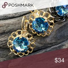 "Handcrafted earrings made with Swarovski crystal Absolutely gorgeous Swarovski crystal earrings in a  ""rivoli"" stone setting. You will feel confident knowing your earrings are unique creations. Crystals are 12mm round and super sparkly. Hubby & I make our jewelry using genuine Swarovski crystals.  All items are brand-new and much prettier in person. Proceeds used to help our 5-yr-old granddaughter Lila May in her fight against cancer, but she lost her battle. Donations now go to other…"