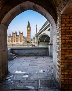 Big Ben, Queen Elizabeth Tower and Wesminster Bridge framed in Arch, London, United Kingdom.