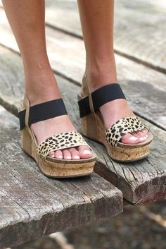 """OMG cuteness! These strappy wedges are to die for! Super comfy too! Tan and black straps with a contrasting leopard print strap across the toes! 3.5"""" heel height. These fit true to size."""