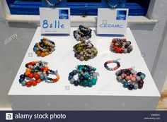 Handmade jewelry Athens Protasis ceramic beads and bracelets on sale outside a souvenir shop in the village of Oia Santorini Stock Photo