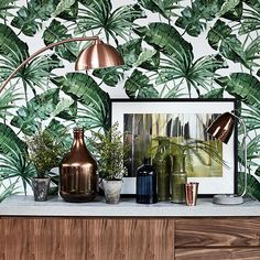 We loved this eclectic sideboard look, which you can achieve by mixing different coloured vases and decorative accessories. Stick to green and copper shades for a tropical twist.