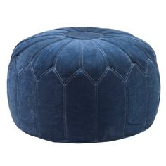 A round pouf floor ottoman like this will make the perfect statement to any rooms décor while providing additional seating.