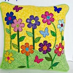 This How to Applique Spring Pillow cover uses pre-cut and fusible applique techniques to show you how to applique a stunning and spring applique onto an already cheerful pillow.