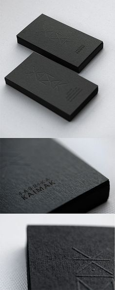 Business Card | simple emboss mixed with black ink on black stock...very expensive yet very sophisticated