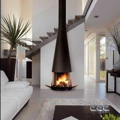 Modern Sitting Room in Whites and  Focal Point Fireplace