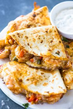 The Best Ever Shrimp Quesadillas A tasty mixture of spicy shrimp, sautéed onions & bell peppers, garlic, and melted cheese crisped in a tortilla. These quesadillas are simple and a delicious way to enjoy shrimp! Calling all shrimp lovers! These DELICIOUS Seafood Recipes, Mexican Food Recipes, Cooking Recipes, Healthy Recipes, Seafood Pasta, Easy Shrimp Recipes, Shrimp Dinner Recipes, Cooks Country Recipes, Cajun Recipes