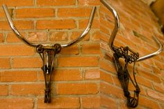 What a spin on the faux taxidermy trend!  A repurposed bike seat and handle bar make...
