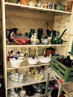 Glassware, corning mugs and serving platters, pitchers, tinware, etc.