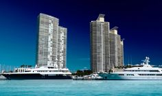 """Murano Grande at Portofino is a residential enclave tower /skyscraper in Miami Beach, Florida's South Beach. It is located directly on Biscayne Bay on the Miami Beach Marina. The tower, which opened in 2003, is 407 ft (124 m) tall and contains 37 floors. It is located in the exclusive """"SOFI""""(South of Fifth Street) neighborhood. It contains some of the largest units in the area (1400 square feet to some well over 5000 square feet)."""
