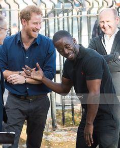 Prince Harry jokes with Trevor Rose as he visits Russell Youth Centre on October 26, 2016 in Nottingham, England.