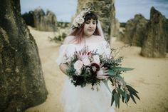 boho bride with king protea bouquet