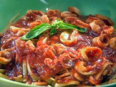 Get Robin Miller's Pan-Seared Calamari with Spicy Marinara over Linguine Recipe from Food Network